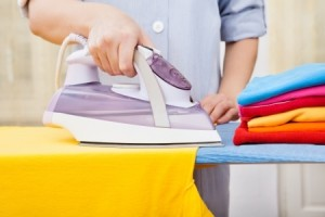 Cleaner Ironing Clothes On Ironing Board
