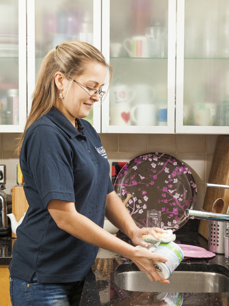 Cleaner washing up for After Party Cleaning London