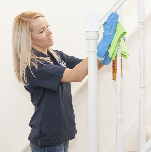 Worker cleaning a stairs for housekeeping London